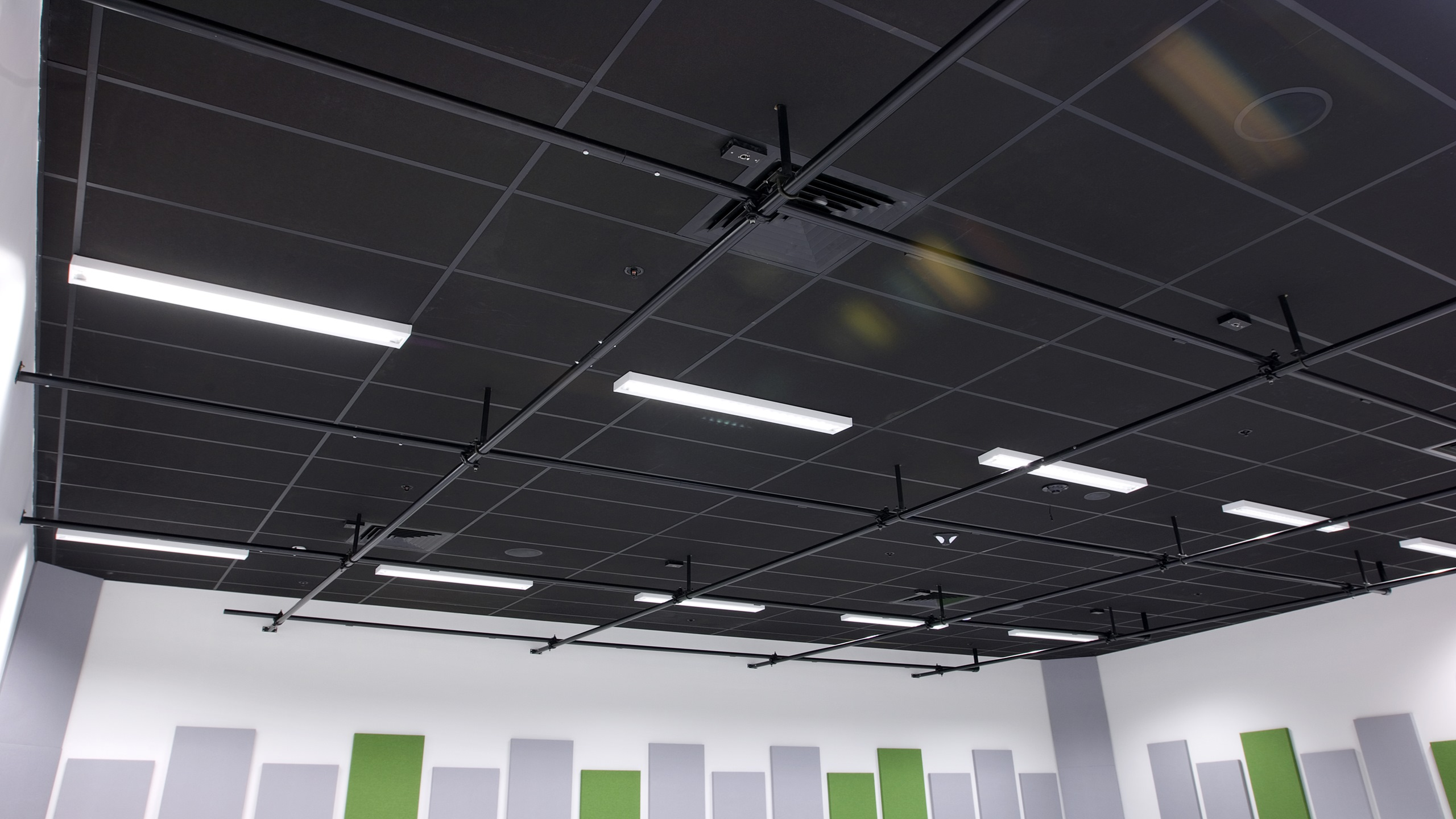 Hobsonville Point Intermediate music room showing  a detail section of the Avant 25 theatre Black ceiling installed into a grid & tile system.